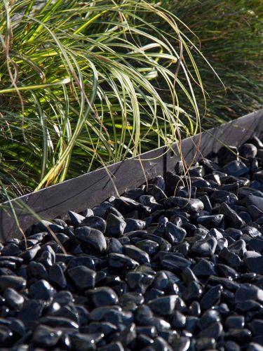 Multi-Edge Afboording (zwart) aangelegd met nero ebano grind